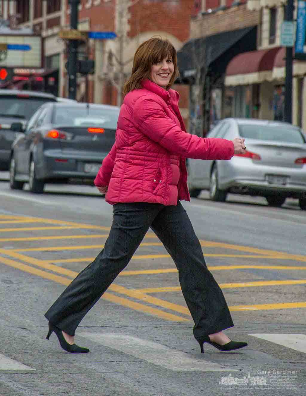 Newly named Uptown Westerville Executive Director Lynn Aventino walks across State Street during a photo session in Uptown.
